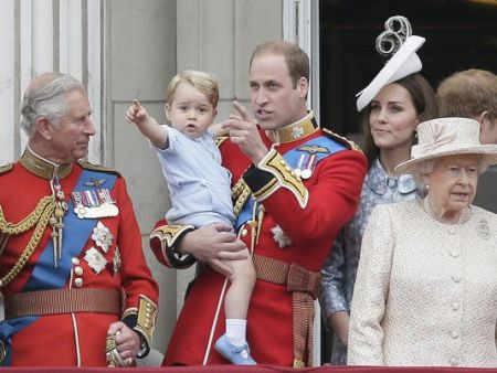 Prince William holds son Prince George, with Queen Elizabeth II, Duchess Kate of Cambridge and Prince Charles at the Trooping the Color parade at Buckingham Palace in London, June 13, 2015. (Photo: Tim Ireland/ AP)