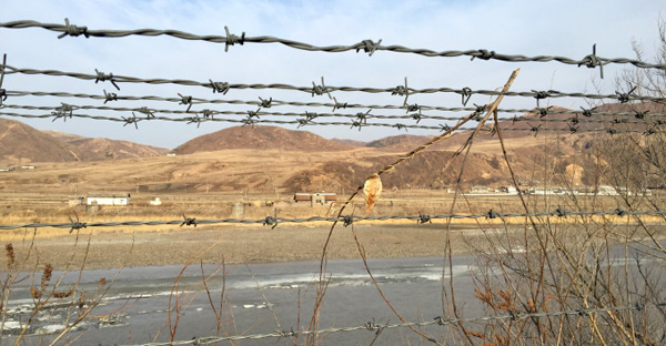 A barbed-wire fence separating North Korea from China. (Reuters)