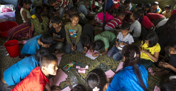 Nepalese children affected by the earthquake gather inside a makeshift shelter in Bhaktapur, Nepal. Aid workers have warned that children are at risk from sex traffickers. (Reuters)