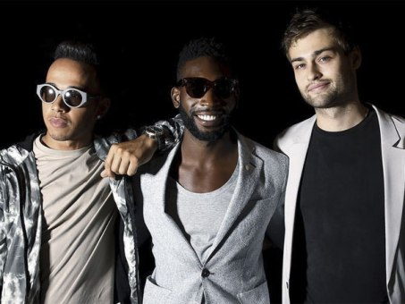 "Formula One racing driver Lewis Hamilton (L), musician Tinie Tempah (C) and actor Douglas Booth pose for photographers following the presentation of the Topman Design Spring/Summer 2015 collection during ""London Collections: Men"" in London, Britain June 12, 2015. REUTERS/Suzanne Plunkett"