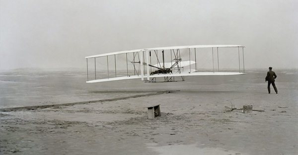 The Wright brothers' 1903 flight marked the first time a manned airplane took off under its own power and landed at a point as high as its starting position. (Library of Congress photo from Wikimedia Commons)