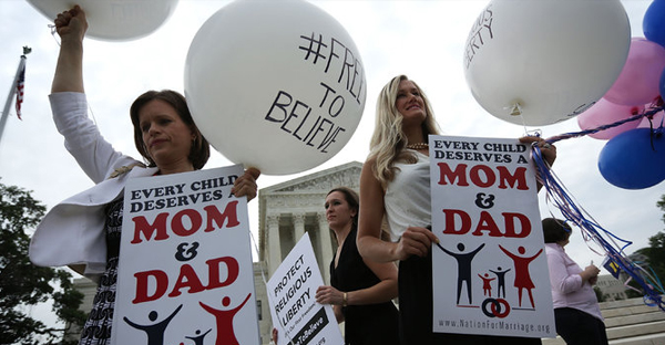 Jennifer Marshall, left, and Summer Ingram, right, demonstrated outside the Supreme Court in Washington on Friday. (Alex Wong/Getty Images)