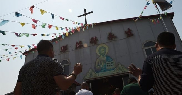 China has restricted the use of crosses outside Protestant and Catholic churches in some provinces (AFP)