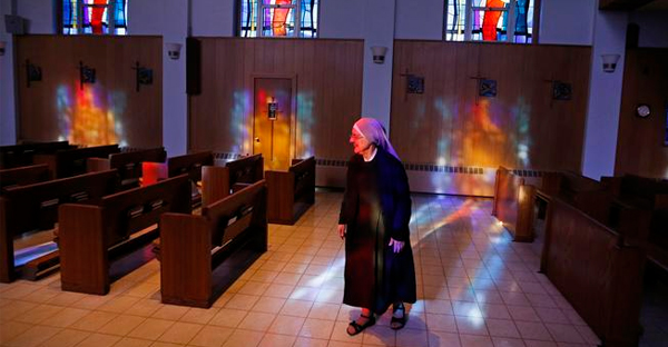 Mother Patricia Mary walks in the chapel at the Mullen Home for the Aged, run by Little Sisters of the Poor, in Denver, Thursday Jan. 2, 2014. (Brennan Linsley, Associated Press file)