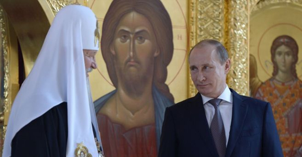 Russian TV viewers are well used to seeing President Putin (right) at Orthodox Church ceremonies.