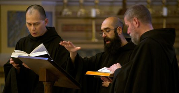 Choirmaster Father Basil Nixen conducts The Monks of Norcia for recording of 'Benedicta' with Father Cassian Folsom, right, and Brother Ignatius of Indonesia. (Photo: De Montfort Music)