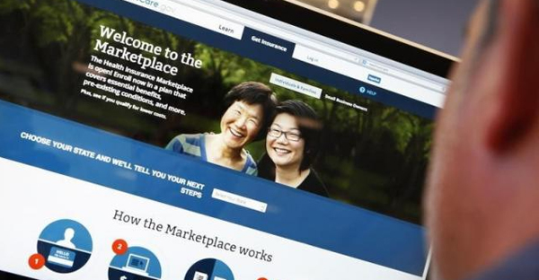 A man looks over the Affordable Care Act (commonly known as Obamacare) signup page on the HealthCare.gov website in New York in this October 2, 2013 photo illustration. (REUTERS/MIKE SEGAR)