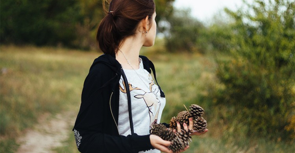 a-MILLENNIAL-gathering-pine-cones