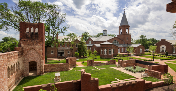 Virginia Theological Seminary's new Immanuel Chapel, dedicated and consecrated Oct. 13, stands beyond the ruins of the 1881 building that was destroyed in a fire Oct. 22, 2010. The ruins are now a memorial garden. (Peter Aaron Otto/Robert A.M. Stern Architects)