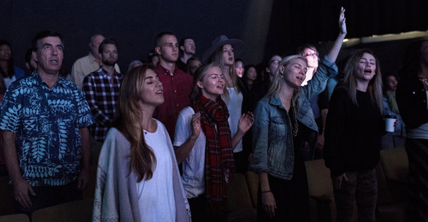 Worshipers sing and dance as the band plays at Mosaic church in Los Angeles, which holds as many as four services on Sundays. (John Francis Peters for The New York Times)