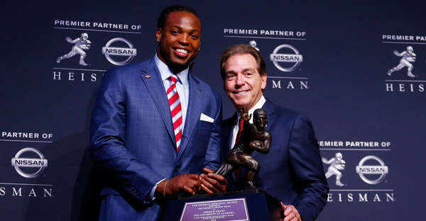 Running back Derrick Henry of the Alabama Crimson Tide poses with coach Nick Saban during a press conference after being named the 81st Heisman Memorial Trophy Award winner during the 2015 Heisman Trophy Presentation at the Marriott Marquis on December 12, 2015 in New York City. (Mike Stobe/Getty Images North America)