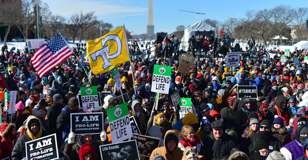 Thousands of people participated in the 2014 March for Life, commemorating the Roe v. Wade ruling. This year, evangelicals are joining in the march. (Nikki Kahn/The Washington Post)