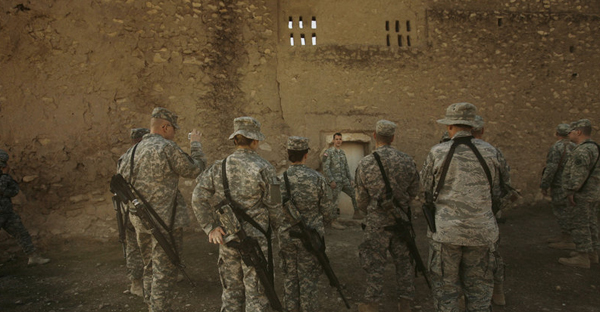 In this photo from Nov. 7, 2008, a U.S. Army chaplain leads soldiers on a tour of St. Elijah's Monastery on Forward Operating Base Marez on the outskirts of Mosul, Iraq. The monastery was apparently destroyed by ISIS in 2014. (Maya Alleruzzo/AP)