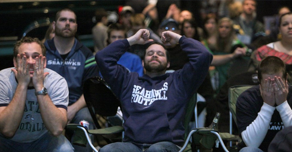 Matt Larkin of Seattle, Kevin Breiwick of Lynnwood and Blair Foerster of Bothell watch a Seahawks game at EastLake Community Church in Bothell in 2011. The church showed the game after its service that year. (Ellen M. Banner / The Seattle Times, 2011)