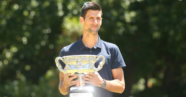 Novak Djokovic of Serbia poses with the Norman Brookes Challenge Cup after winning the Men's Singles Final during the Australian Open 2016 Men's Champion Photocall at Government House on February 1, 2016 in Melbourne, Australia. (Scott Barbour/Getty Images AsiaPac)