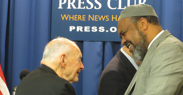 Cardinal Theodore McCarrick greets Former ISNA President Imam Mohamed Magid during a press conference pushing national political parties to reject anti-Muslim bigotry in the elections at National Press Club in Washington, D.C. on April. 14, 2016. (Religion News Service photo by Aysha Khan)