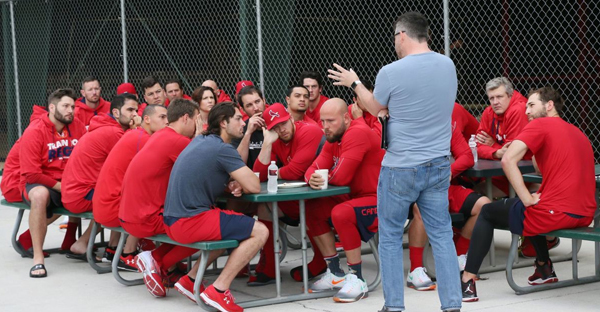 St. Louis Cardinals chaplain Darrin Patrick holds a Sunday morning chapel service for players, coaches and staff outside the clubhouse batting cages during St. Louis Cardinals spring training on Sunday, Feb. 21, 2016, at Roger Dean Stadium in Jupiter, Fla. (Photo by Chris Lee)