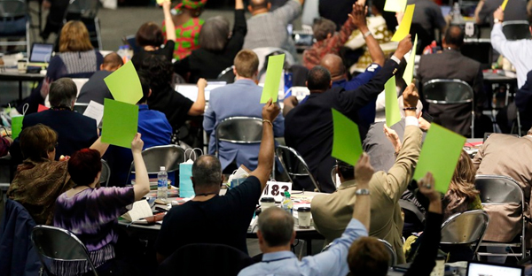 Delegates vote during the General Conference of the United Methodist Church in Portland on Tuesday. (Don Ryan / AP)