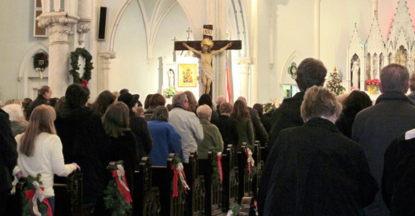 """People gather for Mass inside Our Lady of Perpetual Help Church in Buffalo, N.Y., during a Jan. 12 """"Mass mob."""" Most weeks the church has fewer than 50 in attendance. (AP Photo/Carolyn Thompson)"""