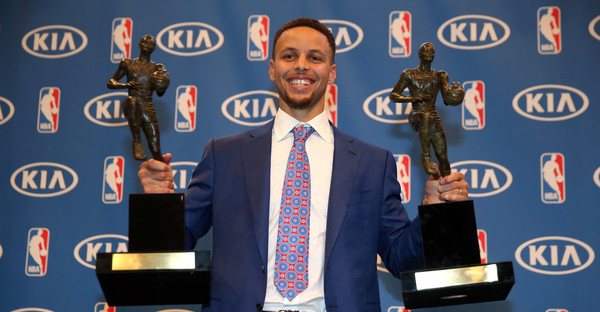 Stephen Curry of the Golden State Warriors poses with his back-to-back NBA Most Valuable Player Awards following a press conference at ORACLE Arena on May 10, 2016 in Oakland, California. (Ezra Shaw/Getty Images North America)