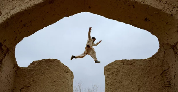 An Afghan boy plays in the ruins of a house that once belonged to the 13th-century Persian poet Rumi. (Photograph: Farshad Usyan/AFP/Getty Images)