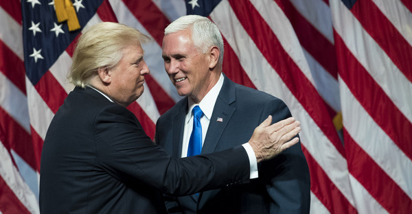 (L to R) Republican presidential candidate Donald Trump greets his newly selected vice presidential running mate Mike Pence, governor of Indiana, as he takes the stage during an event at the Hilton Midtown Hotel, July 16, 2016 in New York City. On Friday, Trump announced on Twitter that he chose Pence to be his running mate. (Drew Angerer/Getty Images North America)