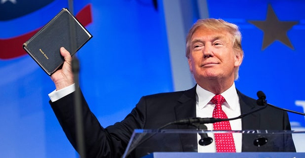 Trump holds up a Bible while speaking at the Values Voter Summit in Washington, D.C., in September. (Angerer/Bloomberg/Getty)