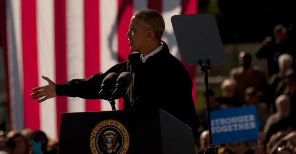 """President Barack Obama campaigns for Hillary Clinton at a """"Get Out the Early Vote"""" rally at Cleveland Burke Lakefront Airport in Cleveland, Ohio on October 14, 2016. Early voting began on October 12 in Ohio. (Jeff Swensen/Getty Images North America)"""