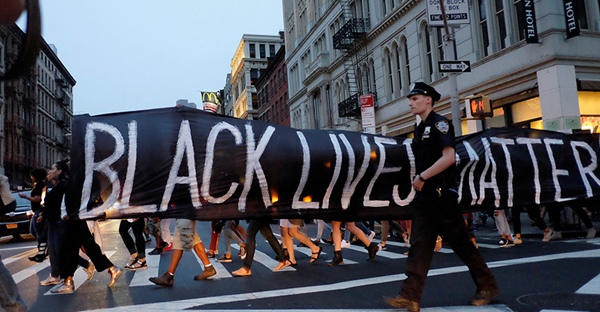 People take part in a protest against police brutality and in support of Black Lives Matter during a march in New York City on July 9, 2016. (Photo courtesy of Reuters/Eduardo Munoz/File Photo)