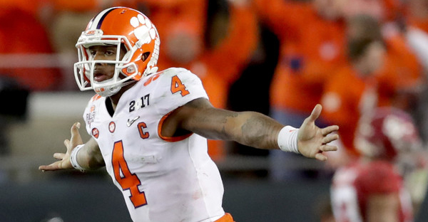 Quarterback Deshaun Watson #4 of the Clemson Tigers celebrates after throwing a 2-yard game-winning touchdown pass during the fourth quarter against the Alabama Crimson Tide to win the 2017 College Football Playoff National Championship Game 35-31 at Raymond James Stadium on January 9, 2017 in Tampa, Florida. (Streeter Lecka/Getty Images North America)