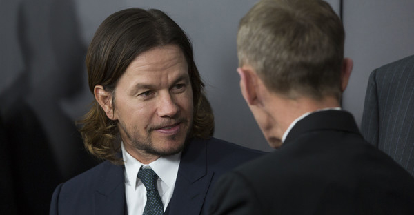 Mark Wahlberg talks with Boston Police Commissioner William Evans on the red carpet before the Special Boston screening of Patriots Day at Wang Theatre on December 14, 2016 in Boston, Massachusetts. (Scott Eisen/Getty Images North America)