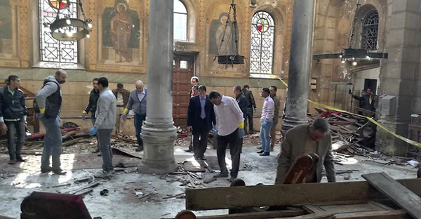 Egyptian security forces examine the scene inside St Mark's Cathedral following Sunday's bombing. (Photograph: Omar El-Hady/AP)