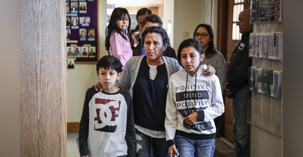 Undocumented immigrant and activist Jeanette Vizguerra, 45, walks into press conference with two of her children Roberto, 10, and Luna Baez, 12, before addressing supporters and the media while seeking sanctuary at First Unitarian Church in Denver on Feb. 15, 2017. (Marc Piscotty, Getty Images)