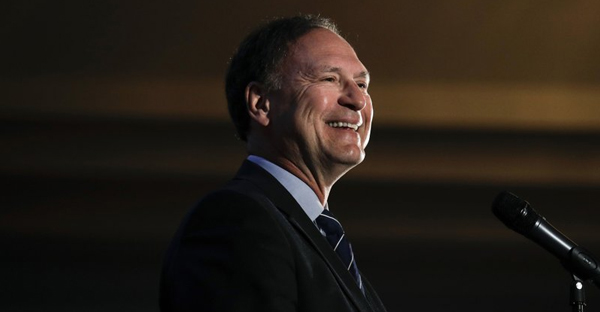 In this Feb. 11, 2017, file photo, Supreme Court Justice Samuel Alito smiles as he delivers a keynote speech at the Claremont Institute's annual dinner in Newport Beach, Calif. Alito said Wednesday, March 15, during a speech sponsored by a Catholic organization in New Jersey that the U.S. is entering a period when its commitment to religious liberty is being tested. (AP Photo/Jae C. Hong, File)
