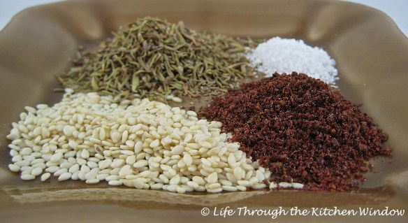 Clockwise from top left: thyme, salt, sumac and toasted sesame seeds