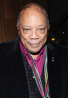 Quincy Jones Music Producer(Jones was the producer, with Michael Jackson, of Jackson's albums Off the Wall (1979), Thriller (1982), and Bad (1987), as well as being the producer and conductor of the 1985 charity song