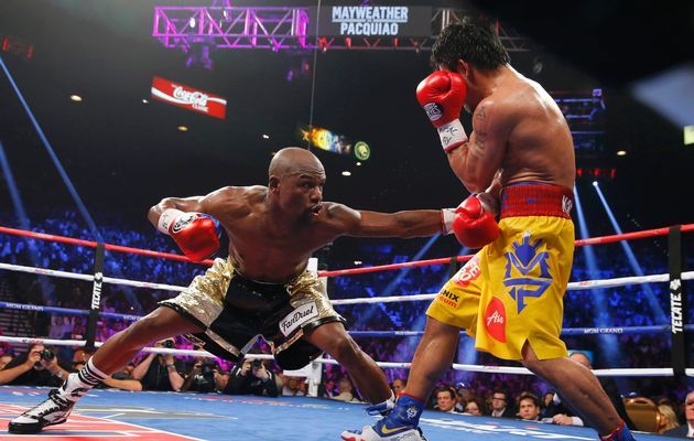 Floyd Mayweather, Jr. of the U.S. stays low against Manny Pacquiao of the Philippines in the eighth round during their welterweight WBO, WBC and WBA (Super) title fight in Las Vegas, Nevada.