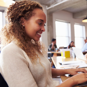 Mandatory Credit: Photo by Monkey Business Images/REX/Shutterstock (5593270a) MODEL RELEASED Businesswoman Using Laptop At Desk In Busy Office VARIOUS