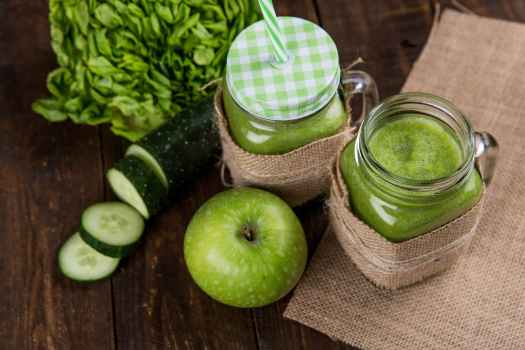 green apple beside of two clear glass jars