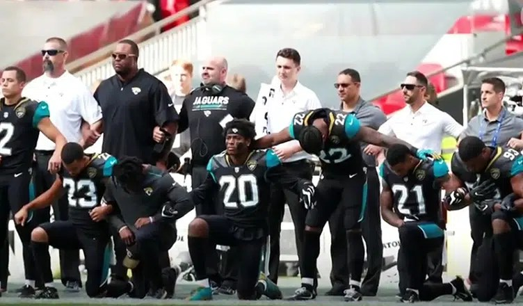Players Kneel During National Anthem. (Credit: YouTube)