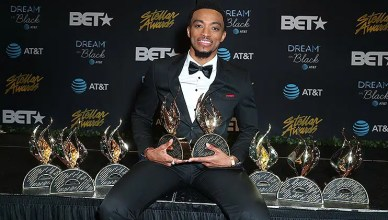 Top winner Jonathan McReynolds embraces his eight trophies at the 34th Stellar Gospel Music Awards (Credit: Central City Productions)