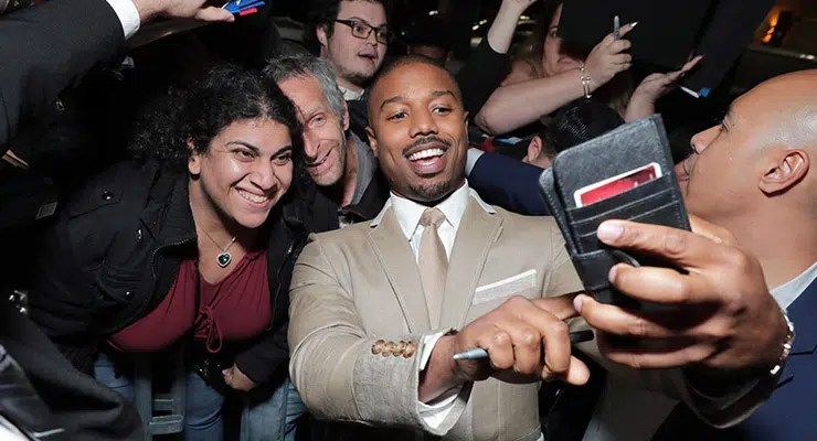 Michael B. Jordan poses with fans at special screening of Just Mercy at the Cinemark Baldwin Hills in Los Angeles, on Jan. 6, 2020. (Credit: Warner Bros.)