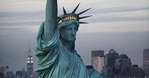 State of Liberty faces southeast, away from Manhattan.