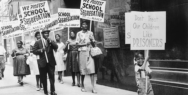 The St. Louis Board of Education was picketed by the NAACP after the Board issued a modified enrollment plan which the NAACP did not go far enough in integrating the schools.