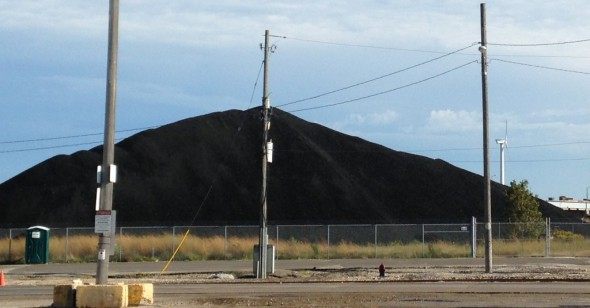 Coal pile, with the Bay View turbine in the background. Photo by Dave Reid.