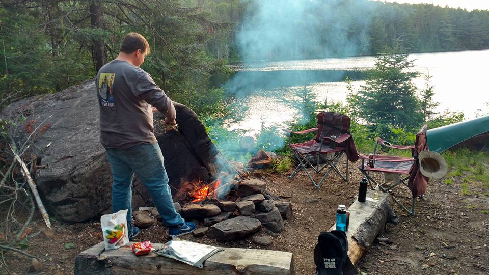 Brian tends fire on Tom Thomson lake site