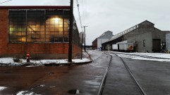 Revisiting this classic strip district scene with mixed artificial/natural light, rail road tracks, warehouses, rust, wet pavement, and reflections.