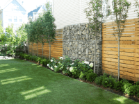 Wood Slat Privacy Fence With Gabion Rock Wall and ...
