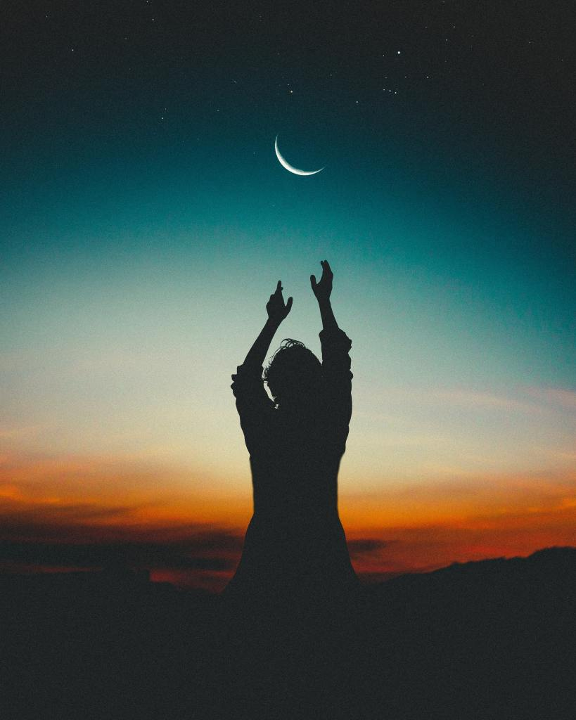 Pexel Photography by Luis Clas man standing in sunset astrology post with moon in crescent
