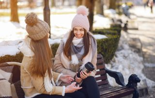 Girls discussing winter hair care tips
